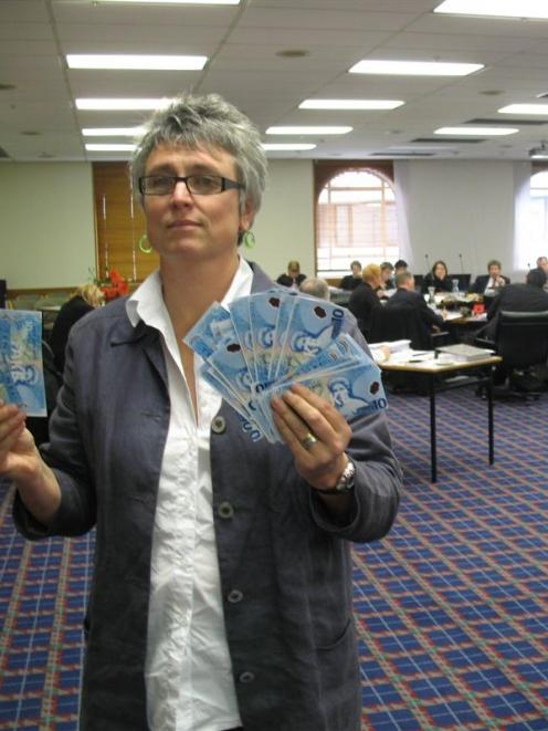 Methodist Mission chief executive Laura Black holds fake money she used as a prop during annual...