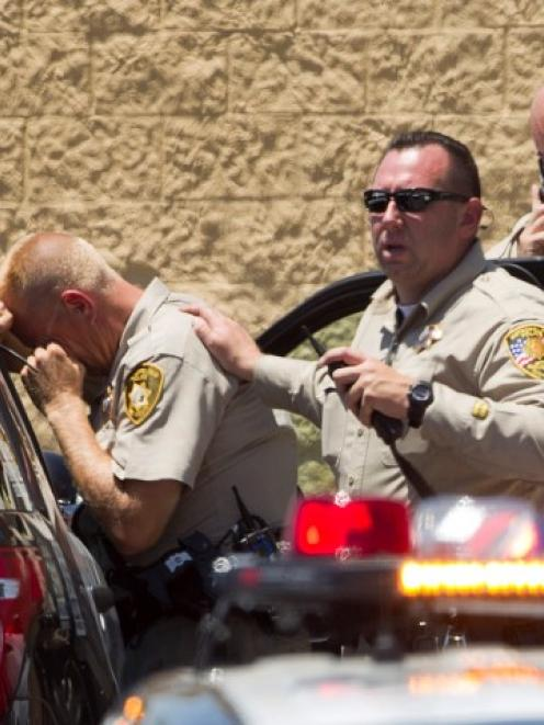 Metro Police officers at the scene outside the Wal-Mart store. REUTERS/Las Vegas Sun/Steve Marcus