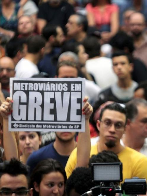 Metro workers debate whether to continue their strike at a meeting in Sao Paulo. REUTERS...