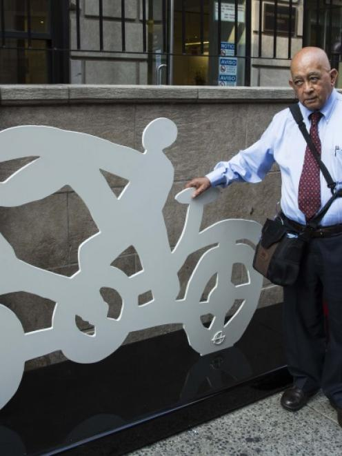Mexican artist Gilberto Aceves Navarro with two of his bicycle sculptures in New York. The 82...