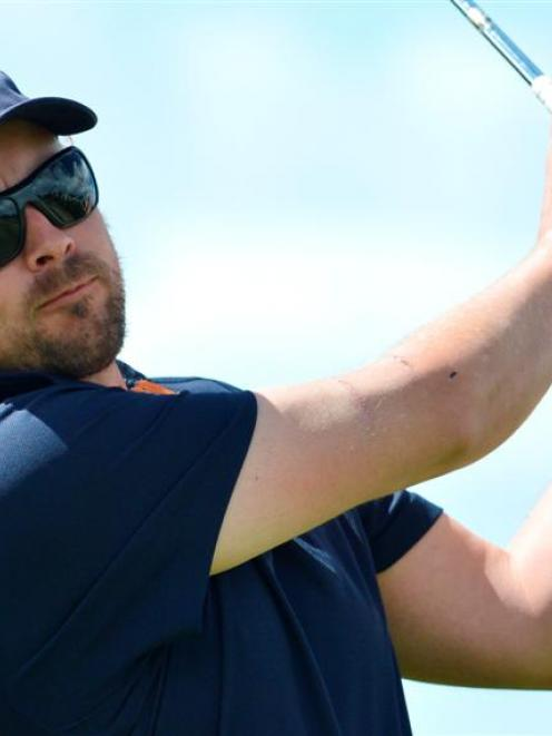 Michael Smith follows his tee shot on the seventh hole during the Otago team's practice round for...