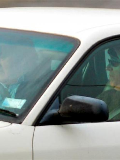 Michael Swann (right) leaves Christchurch Men's Prison early yesterday. Driving is his new...