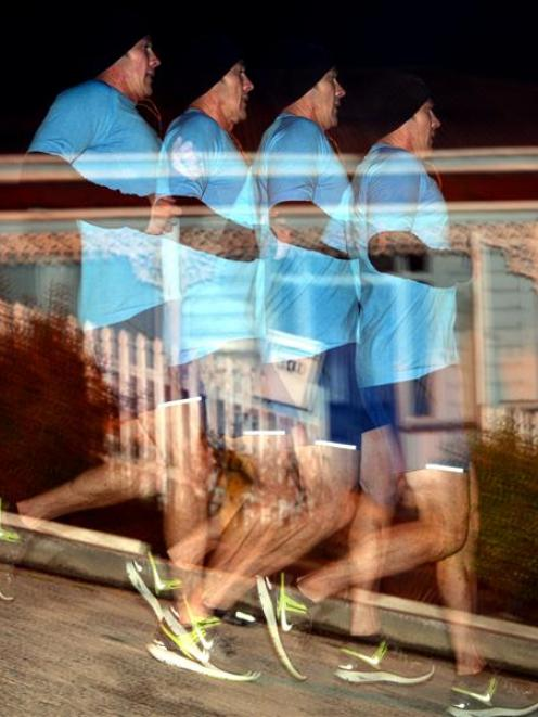 Mike Horne runs down Baldwin St, Northeast Valley, as part of a fundraiser for the Otago...