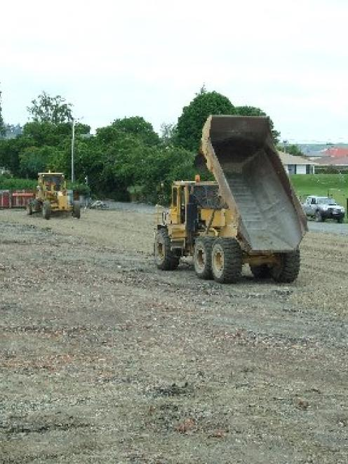 Mike Hurring Contractors staff dump and grade loads of gravel over the old Dreaver Courts site in...