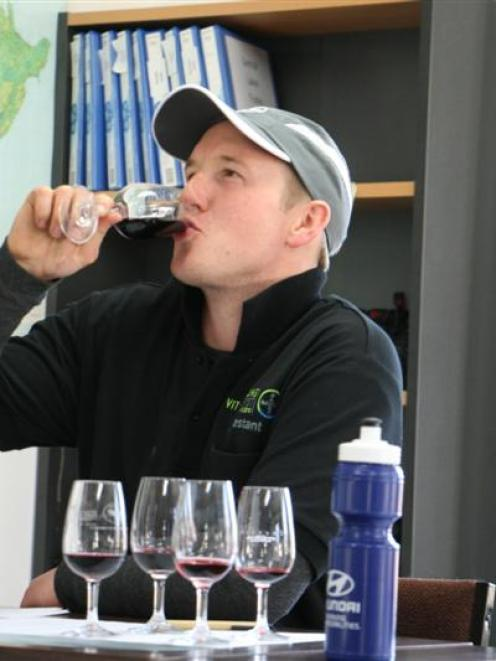 Mike Winter, of Cromwell, during the wine tasting section of a young viticulturist  competition...