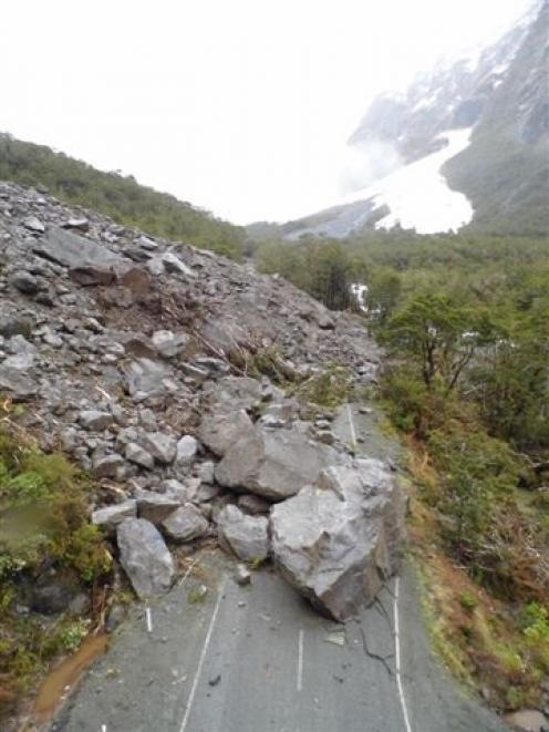 Milford Road has been blocked by a slip that sent rocks - some the size of small cars - tumbling...