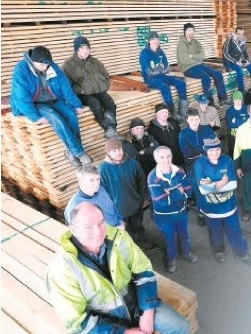 Millstream Lumber manager Murray Daniel (foreground) and his staff of about 50 employed at the...
