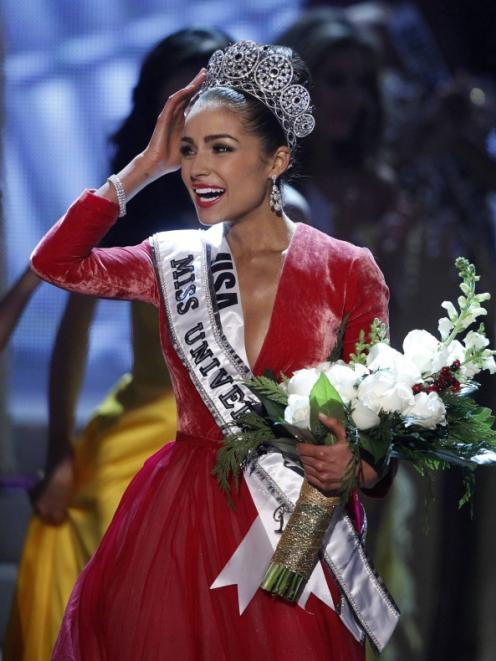 Miss USA Olivia Culpo reacts after being crowned during the Miss Universe pageant at Planet...
