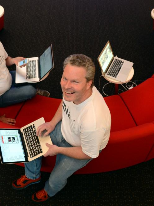 MixBit lead developer Joshua Garner (left) and developer George Sealy at work in the thriving IT...