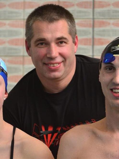 Moana Pool coach Gennadiy Labara and Otago swimmers Kate Godfrey and Matthew Glassford are...