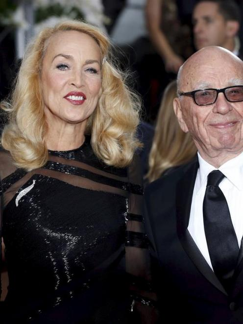 Model Jerry Hall and media magnate Rupert Murdoch announced their engagement  in an advertisement...