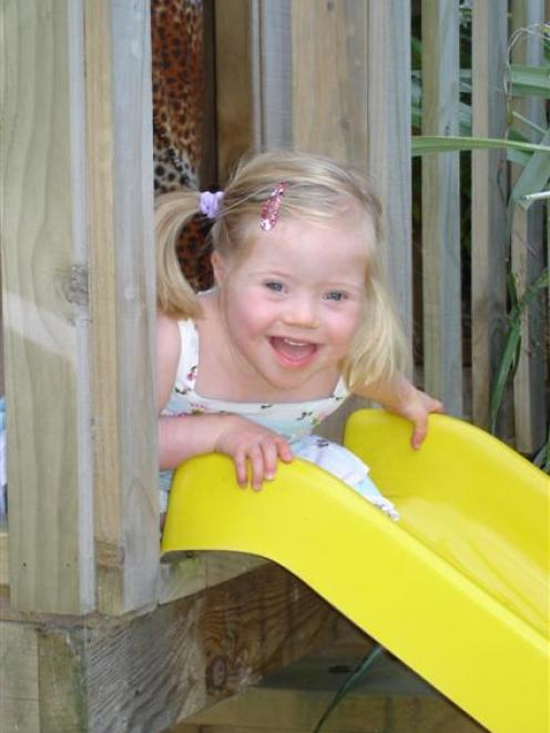 Mollie Kerruish (3) may not mind waiting for her turn on a slide, but hospital waits are not so...