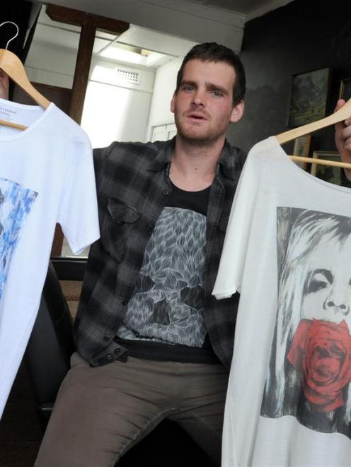 Moodie Tuesday creative director Jon Thom with some of his designer T-shirts. Photo by Craig Baxter.