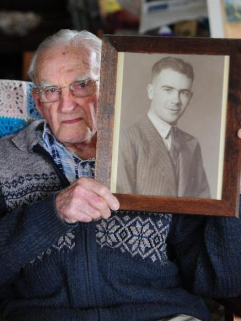 Mosgiel resident Bob Heenan holds a photograph of his brother Arthur, who was one of 17 New...