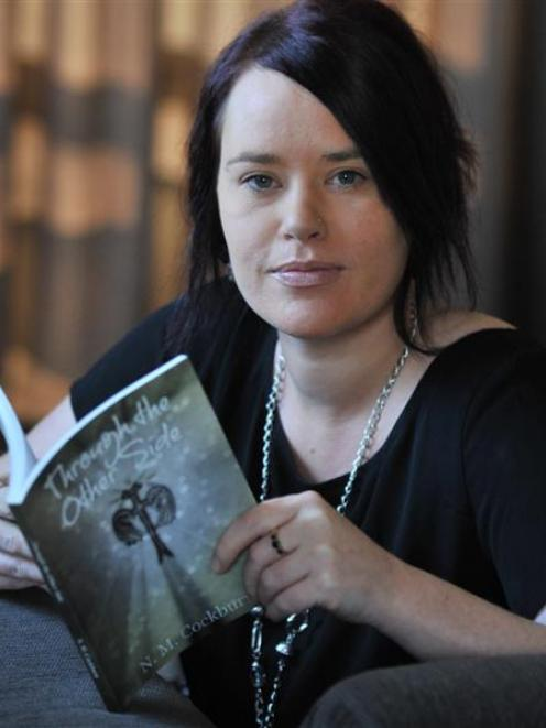 Mosgiel woman Nikki Cockburn has written a book about her experience of her partner's suicide....