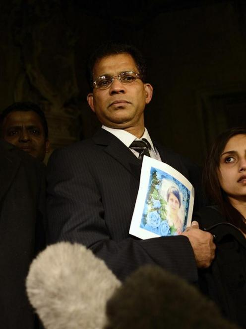 MP Keith Vaz addresses the media as Lisha Barboza stands with her father Ben while he holds a...
