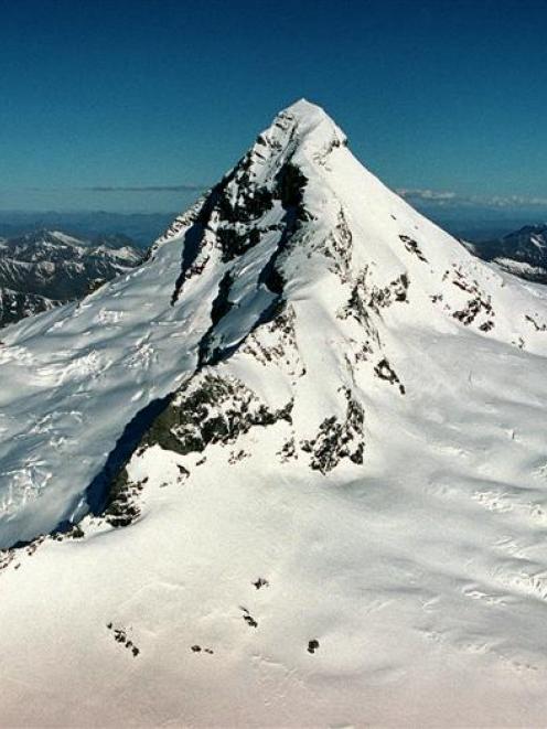 Mt Aspiring's northwest (left) and southwest ridges. A Singaporean climber yesterday fell from...