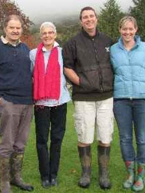 Mt Aspiring Station farmers John and Sue Aspinall (at left) and their son Randall and his wife...