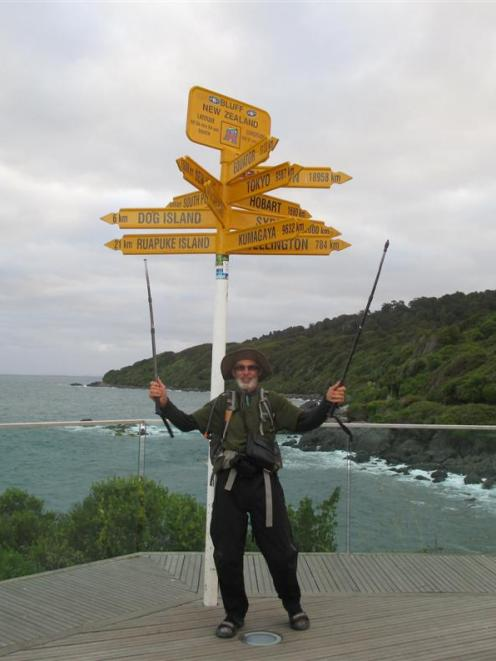 Murray Faulkner celebrates in Bluff on February 13 after completing the Te Araroa trail. Photos...
