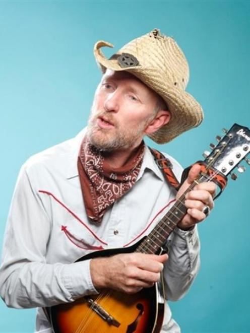 Musician Russell Scoones, of Auckland, is staging a charity concert tonight  'for the kids'....