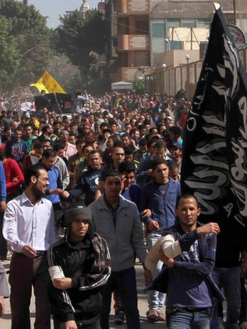 Muslim Brotherhood supporters shout slogans during a recent protest in Matarya area, east of...