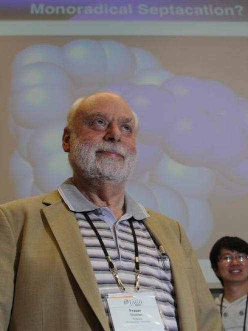 Nanotechnology pioneer Prof Sir Fraser Stoddart, of Scotland, with members of his research team, ...