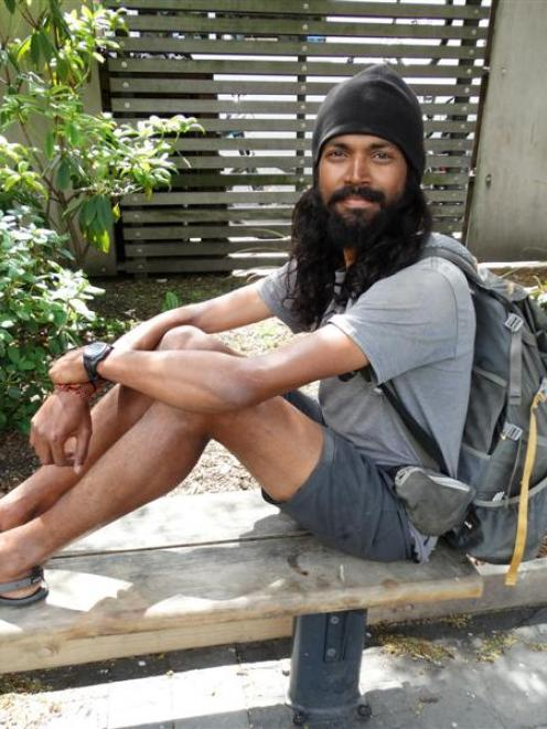 Naresh Kumar takes a break  in Queenstown yesterday on his journey the length of New Zealand....