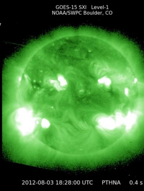 NASA and NOAA's Geostationary Operational Environmental Satellite Solar X-ray Image shows the Sun...