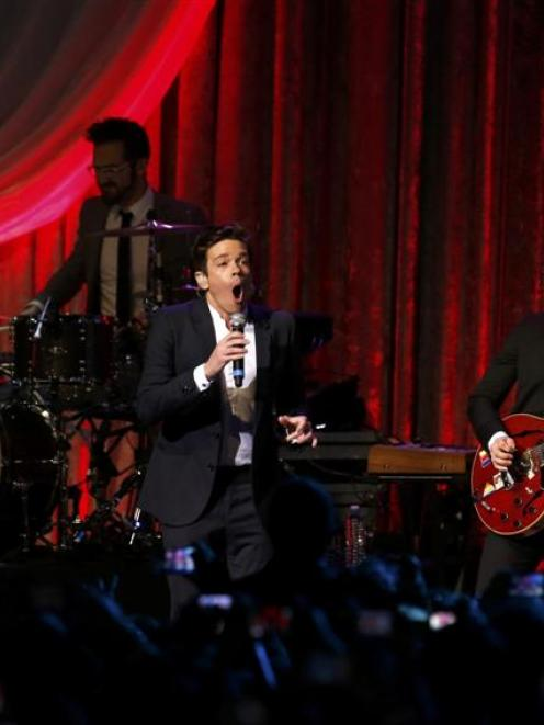 Nate Ruess (centre), Andrew Dost (rear) and Jack Antonoff, of the band fun., perform at the...