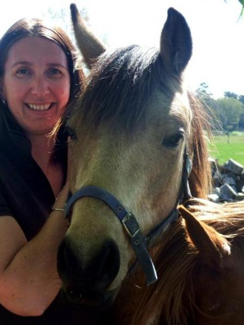 Natural resources engineer Keri Johnston at home on the farm with her horses. Photo supplied.