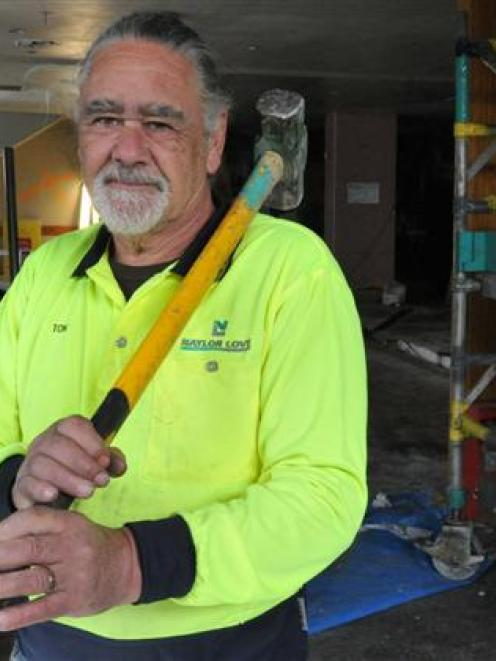 Naylor Love foreman Tom Duff takes a break from demolition work at the Captain Cook Tavern. Photo...