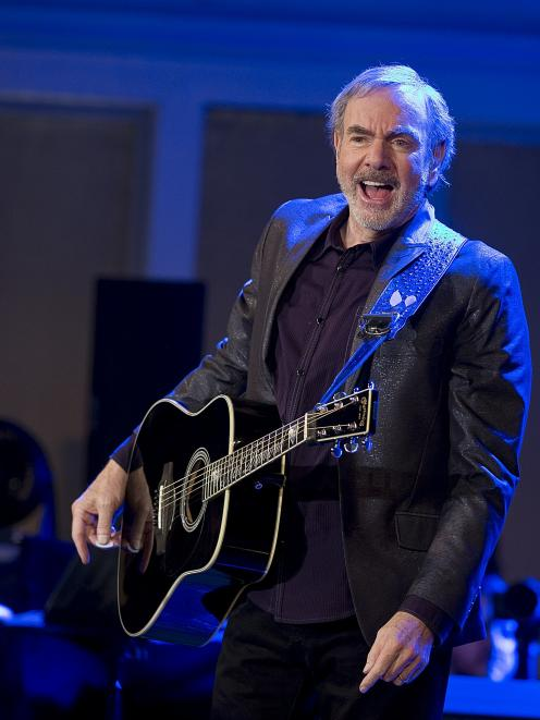 Neil Diamond performs on a TV special in the US earlier this year. Photo by Getty Images.