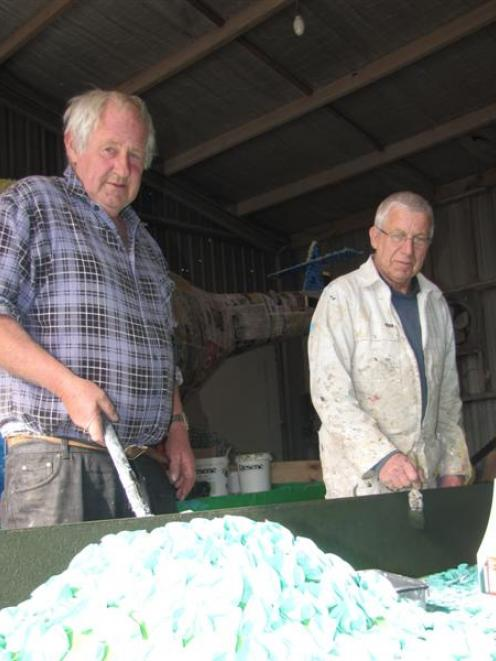 Neil McArthur (left) and Brian Phillips, both of Alexandra,   paint  the St John float for the...