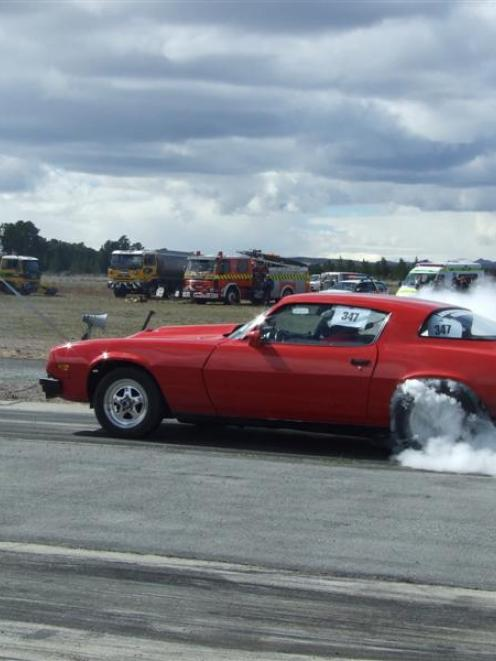 Neil Robertson, of  Oamaru, guns his hot Camaro at Alexandra in 2011. Photo by Lynda van Kempen.
