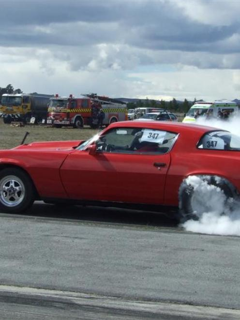 Neil Robertson, of Oamaru, revs up at the Blossom Festival Drags held on the runway at Alexandra...
