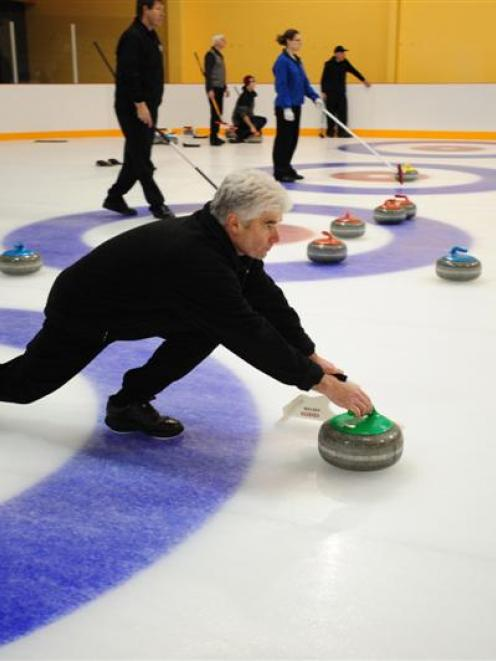 Nelson Ede, of the Maniototo senior (over-50) team, delivers a stone during the New Zealand...