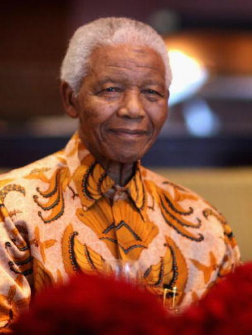 Nelson Mandela is shown in this 2009 file photo.  (Photo by Chris Jackson/Getty Images)