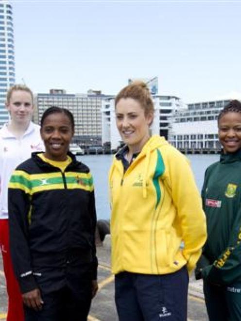 Netball players (L-R) Mwai Kumwenda (Malawi), Laura Langman (NZ), Joanne Harten (England), Nadine...