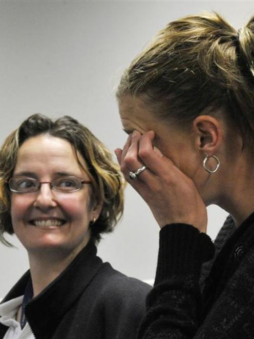 Neurosurgery survivor Nicki Fairbairn (left) supports fellow survivor Casey Coombes as she wipes...