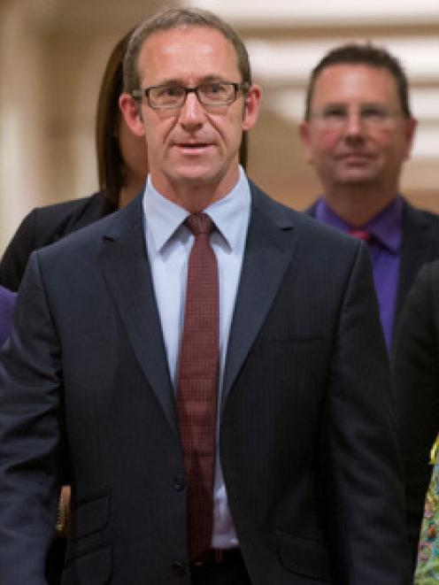 New Labour Party leader Andrew Little with MP Annette King, left, and party president Moira...