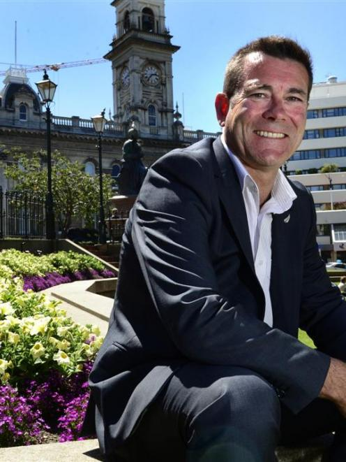 New Minister outside Cabinet Michael Woodhouse enjoys  the sun in the Octagon yesterday. Photo by...