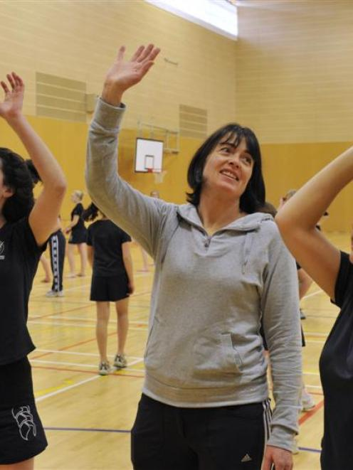 New Steel co-coach Janine Southby passes on a few tips to Columba College pupils Georgia Nichol ...