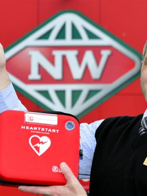 New World Centre City Dunedin manager Tony Watts with one of the defibrillators that are mapped...