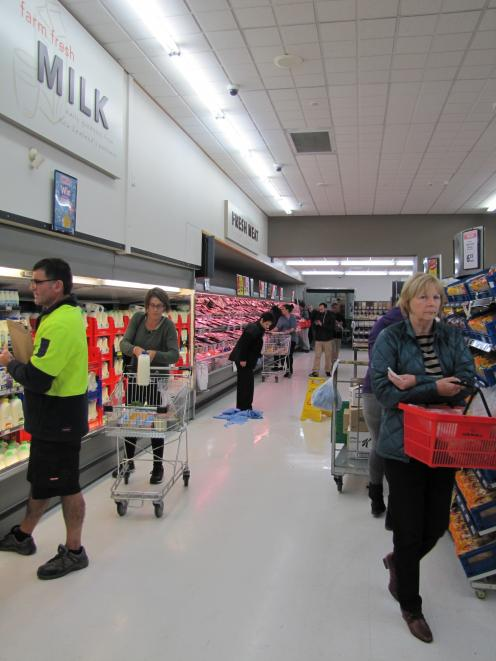 New World Supermarket staff in Wanaka mop up spilt milk after today's earthquake. Photo by Mark...