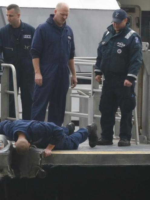 New York City emergency responders investigate a commuter ferry crash that occurred during the...