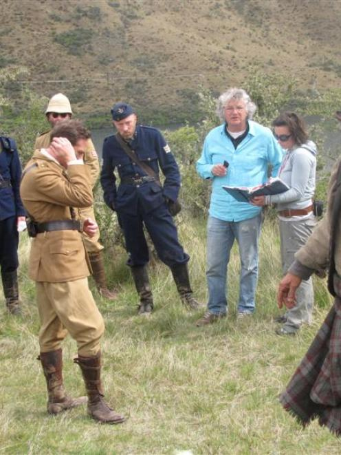 New Zealand actor Andy Henderson runs lines for filming of Tracker at Moke Lake yesterday,...