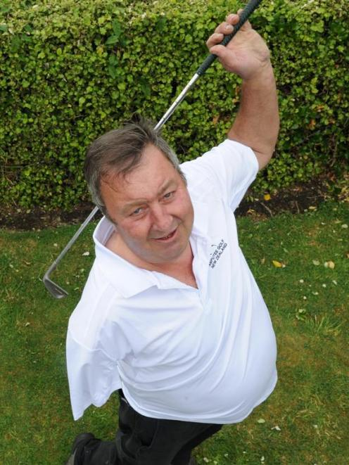 New Zealand amputee golf champion Tony Wilson shows his golfing style yesterday. Photo by Craig...