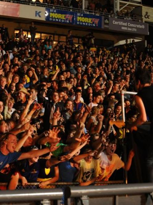 New Zealand band Shihad entertains a packed terrace at Carisbrook on Saturday night. Photo by...