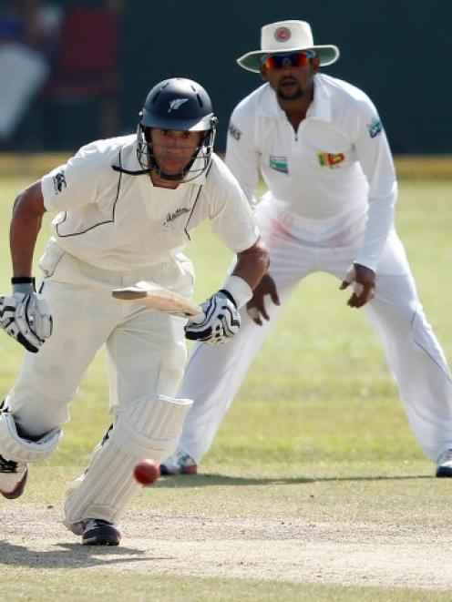 New Zealand captain Ross Taylor watches his shot as he runs between wickets during the second...