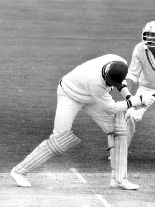 New Zealand fielder Stephen Boock looks on as West Indian batsman Joe Garner is bowled by Richard...